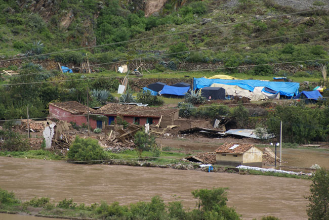 Homes washed away by the river