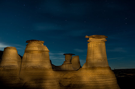 Photo of the hoodoos in Drumheller Alberta at night by student Karen Albert