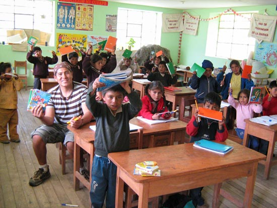Washi and the kids in school in Peruvian village